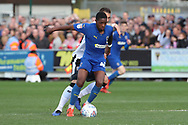 AFC Wimbledon attacker Michael Folivi (41) battles for possession with Gillingham defender Max Ehmer (5) during the EFL Sky Bet League 1 match between AFC Wimbledon and Gillingham at the Cherry Red Records Stadium, Kingston, England on 23 March 2019.