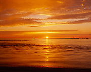 Sunset over Lake Superior viewed from the mouth of the Sand River, Lake Superior Provincial Park, Ontario.
