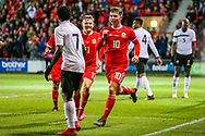 Wales midfielder Ben Woodburn scores and celebrates a goal 1-0 during the Friendly European Championship warm up match between Wales and Trinidad and Tobago at the Racecourse Ground, Wrexham, United Kingdom on 20 March 2019.