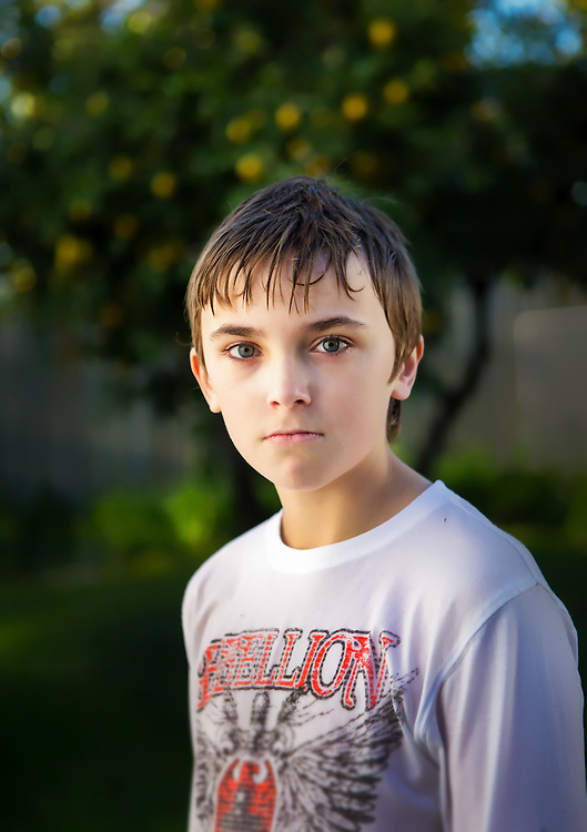 Portrait of a boy with wet hair in front of a lemon tree. melbourne photographers, commercial photographers, industrial photographers, corporate photographer, architectural photographers, This photograph can be used for non commercial uses with attribution. Credit: Craig Sillitoe Photography / http://www.csillitoe.com<br /> <br /> It is protected under the Creative Commons Attribution-NonCommercial-ShareAlike 4.0 International License. To view a copy of this license, visit http://creativecommons.org/licenses/by-nc-sa/4.0/.