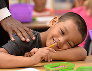 August 12, 2013 -Tucker -Javan Carter smiles as DeKalb County School District Superintendent Michael Thurmond  touches his shoulder on the first day of school inside his first grade class at Midvale Elementary on Monday, August 12, 2013. DeKalb was one of the metro school districts that started school today.  ©2013 Johnny Crawford