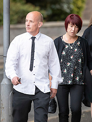 © Licensed to London News Pictures. 18/07/2018. Woking, UK.  The family of Private (Pte) Sean Benton arrive at Woking Coroner's Court.  Pte Benton's sister Tracy Lewis and twin brother Tony Benton (L) will hear the coroner read out his full ruling today. Pte Sean Benton was found with five gunshot wounds to his chest at Deepcut army base in 1995. Photo credit: Peter Macdiarmid/LNP