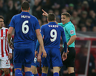 Referee Craig Pawson tells Jamie Vardy of Leicester City to leave the pitch during the English Premier League match at the Bet 365 Stadium, Stoke on Trent. Picture date: December 17th, 2016. Pic Simon Bellis/Sportimage