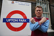 a West Ham fan poses with an Iron Cross in front of the Upton Park London Underground sign. scenes around the Boleyn Ground, Upton Park in East London as West Ham United play their last ever game at the famous ground before their move to the Olympic Stadium next season. Barclays Premier league match, West Ham Utd v Man Utd at the Boleyn Ground in London on Tuesday 10th May 2016.<br /> pic by John Patrick Fletcher, Andrew Orchard sports photography.