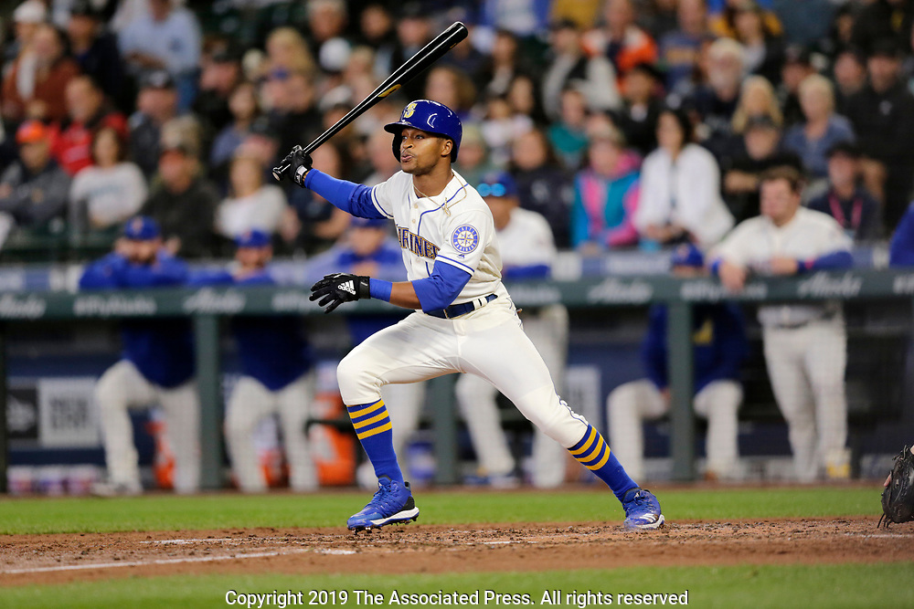 Seattle Mariners' Mallex Smith hits an RBI single against the Chicago White Sox during a baseball game, Sunday, Sept. 15, 2019, in Seattle. (AP Photo/John Froschauer)