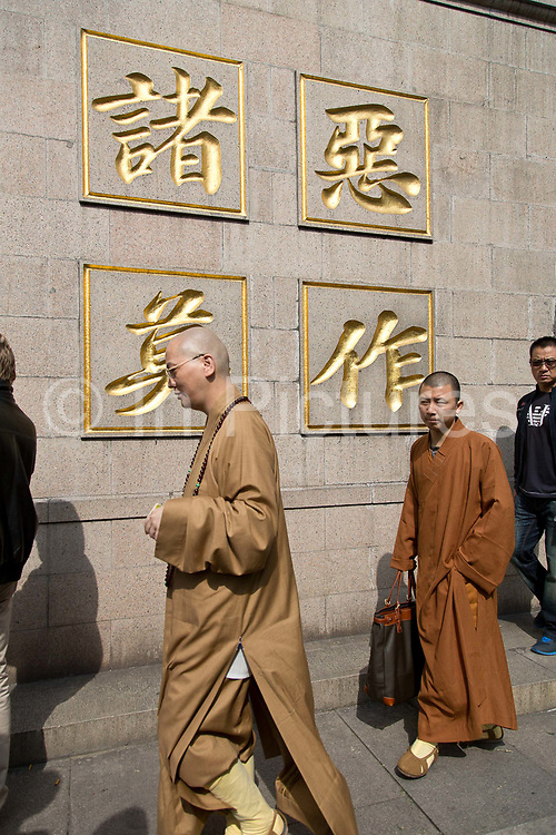 Jing'an Temple on Nanjing West RoadBudhist monks walk through the Jing'an Temple in Shanghai, China on 30 October 2013.  The temple, now in the heart of Shanghai's commercial district, dates back to the late Han dynasty ago in 247 AD.