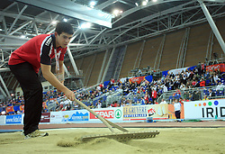 Caring for sand at the 1st day of  European Athletics Indoor Championships Torino 2009 (6th - 8th March), at Oval Lingotto Stadium,  Torino, Italy, on March 6, 2009. (Photo by Vid Ponikvar / Sportida)