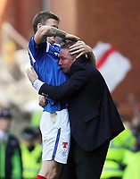 Football - Scottish Premier League - Rangers vs. Celtic<br />  <br /> Rangers manager Ally McCoist celebrates with Dorin Goian after Andrew Little of Rangers scores with his first touch of the ball after coming on as a substitute during the third Old Firm encounter of the season during the Rangers vs Celtic Scottish Premier League match at Ibrox Stadium Glasgow on March 25th 2012 <br /> <br /> Ian MacNicol/Colorsport