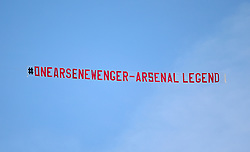 A plane flies over the pitch displaying a banner honouring outgoing manager Arsene Wenger