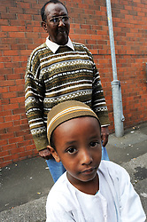 Somali refugee father and son; Bolton, Yorkshire UK