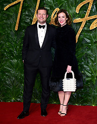 Dermot O'Leary and Dee Koppang (right) attending the Fashion Awards in association with Swarovski held at the Royal Albert Hall, Kensington Gore, London.