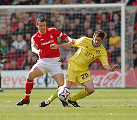 Photo: Leigh Quinnell.<br /> Nottingham Forest v Colchester United. Coca Cola League 1. 08/04/2006. Forest captain Ian Breckin challenges Colchesters Scott Vernon.