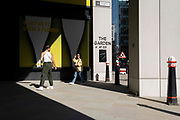 In the week that many more Londoners returned to their office workplaces after the Covid pandemic, City workers walk through sunlight and shadows in the City of London, the capitals financial district, on 8th September 2021, in London, England.