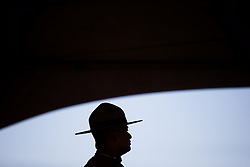 An RCMP officer is silhouetted during a special Canada Day citizenship ceremony in West Vancouver, B.C., on Saturday, July 1, 2017. Photo by Darryl Dyck/CP/ABACAPRESS.COM