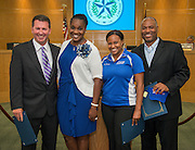 Trustee Wanda Adams, 2nd from left, recognizes Westbury High School staff during the Houston ISD Board of Education meeting, August 14, 2014.