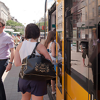 Passengers travel with tram number four on the street in Budapest, Hungary on July 06, 2011. ATTILA VOLGYI