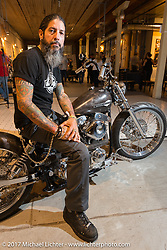 Custom builder and Buckcherry drummer Xavier Muriel in the In Motion invitational bike show build to other builders and judges during the Lone Star Rally. Galveston, TX. USA. Friday November 3, 2017. Photography ©2017 Michael Lichter.