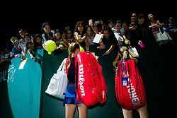 October 26, 2018 - Kallang, SINGAPORE - Kristina Mladenovic of France & Timea Babos of Hungary sign autographs after winning their doubles quarterfinal match at the 2018 WTA Finals tennis tournament (Credit Image: © AFP7 via ZUMA Wire)
