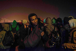 October 24, 2016 - Calais, France - The first migrants doing the queue to take the bus to be accomodated in a center in France. Around 7 o clock in the morning, the first migrants arrived at the warehouse to be registered and dispached by buses, all around the French territory. Calais,  France, on 24 October 2016  (Credit Image: © Guillaume Pinon/NurPhoto via ZUMA Press)