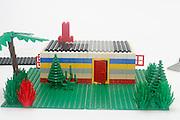 Lego House construction on white background