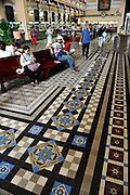 Interior of the Saigon Central Post Office (Buu Dien Truong Tam). The Post Office was designed and built (1886--1891) by Gustave Eiffel, builder of the Eiffel Tower. Ho Chi Minh City (Saigon), Vietnam