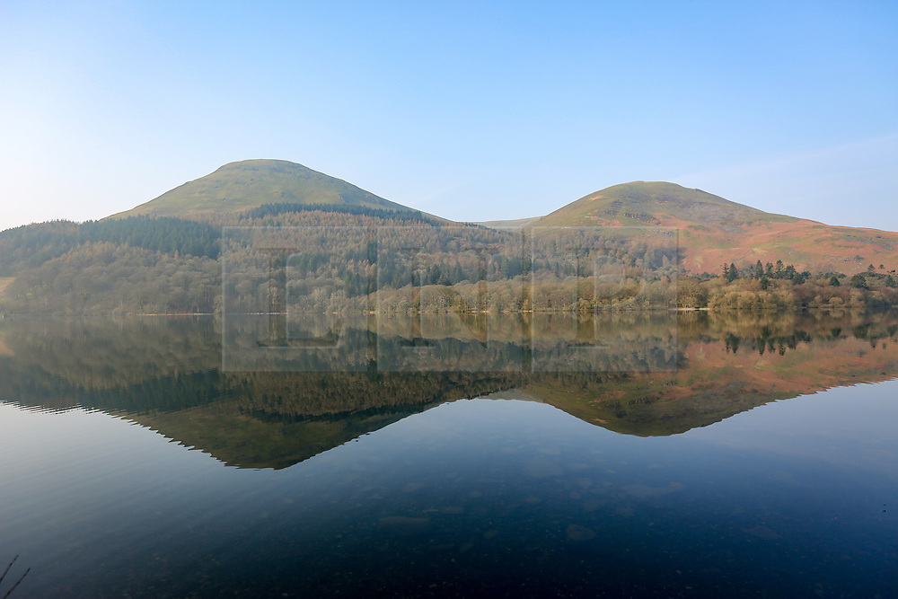 © Licensed to London News Pictures. 28/03/2017. Buttermere UK. The mountains that surround Loweswater reflect in the calm water on another sunny day in Cumbria. Photo credit: Andrew McCaren/LNP