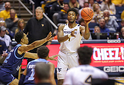 Dec 1, 2019; Morgantown, WV, USA; West Virginia Mountaineers forward Derek Culver (1) passes the ball during the second half against the Rhode Island Rams at WVU Coliseum. Mandatory Credit: Ben Queen-USA TODAY Sports
