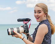 young blonde woman on beach with canon video camera by Tallmadge photographer Mara Robinson, Tallmadge photography, Akron photography, Akron photographer, Tallmadge portrait photographer