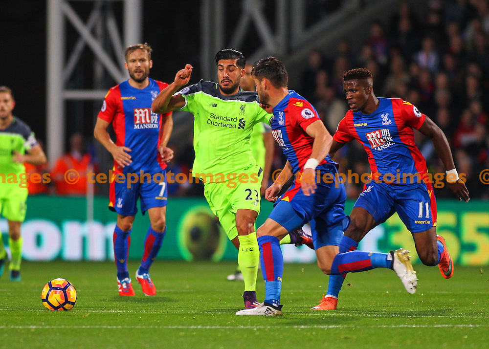 Emre Can fends off two opposing players during the Premier League match between Crystal Palace and Liverpool at Selhurst Park in London. October 29, 2016.<br /> Jack Beard / Telephoto Images<br /> +44 7967 642437