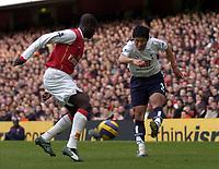 Photo: Olly Greenwood.<br />Arsenal v Tottenham Hotspur. The Barclays Premiership. 02/12/2006. Arsenal's Emmanuel Eboue and Tottenham's Lee Young-Pyo