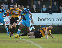 Photo: Ian Hebden.<br />Boston United v Wycombe Wanderers. Coca Cola League 2. 18/02/2006.<br />Boston's Austin McGann (L), Wycombe's Kevin Betsy (C) and Boston's Stuart Talbot (R) battle for the ball.