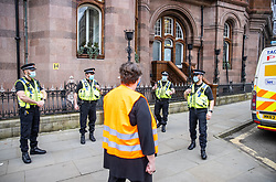 © Licensed to London News Pictures. 07/03/2021. Manchester, UK. Police issue a £2,000 fixed penalty notice to event organiser , Mental Health Nurse KAREN REISSMANN (61) . Police break up what they say is an illegal gathering under Coronavirus legislation as nurses and their supporters attempt to protest in St Peter's Square in Manchester City Centre over the British Government proposing a one percent pay increase to nurses' salaries . Photo credit: Joel Goodman/LNP