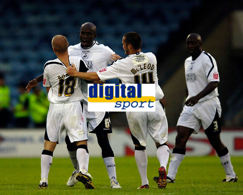 Photo: Jed Wee.<br /> Scunthorpe United v Swansea City. Coca Cola League 1. 08/08/2006.<br /> <br /> Swansea's Ezumo Iriekpen (6) celebrates with goalscorer Andy Robinson (18).