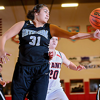 012114       Cable Hoover<br /> <br /> Miyamura Patriot Michelle Livingston (31) passes the ball away from Grants Pirate Jami Stverak (20) Tuesday at Grants High School.