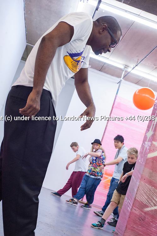 (c)Licensed to London News Pictures. 24/08/2014. London. England. Popin' Pete's Pop Shop, a three day celebration of body popping and hip-hop culture for the whole family at the London Newcastle Space. Conceived and produced by Kate Scanlan of Scanner's Inc it is the second annual pop up festival of hip hop culture. August 24 2014. Photo credit Carole Edrich/LNP