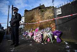 © Licensed to London News Pictures. 04/04/2018. London, UK. A police officer stands next to floral tributes left on Chalgrove Road, Tottenham, north London, the scene where 17 year old Tanesha Melbourne, was shot dead on Monday. A recent spree of killings in the capital has taken the murder toll for the year so far to 48. Photo credit: Ben Cawthra/LNP