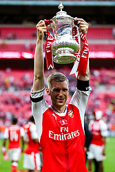 Per Mertesacker of Arsenal celebrates after Arsenal win the match 2-0 to become FA Cup Winners - Rogan Thomson/JMP - 27/05/2017 - FOOTBALL - Wembley Stadium - London, England - Arsenal v Chelsea - FA Cup Final.