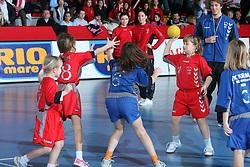 Children playing handball in the halftime at EHF Champions league handball match in Group II between RK Krim Mercator and Gyori Audi Eto KC, on February 7, 2009, in Kodeljevo, Ljubljana, Slovenia. Gyori won 35:31. (Photo by Vid Ponikvar / Sportida)