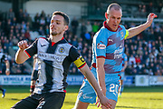 Paul McGinn (C) of St Mirren and Kenny Miller of Dundee FC challenge for the ball during the Ladbrokes Scottish Premiership match between St Mirren and Dundee at the Paisley 2021 Stadium, St Mirren, Scotland on 30 March 2019.