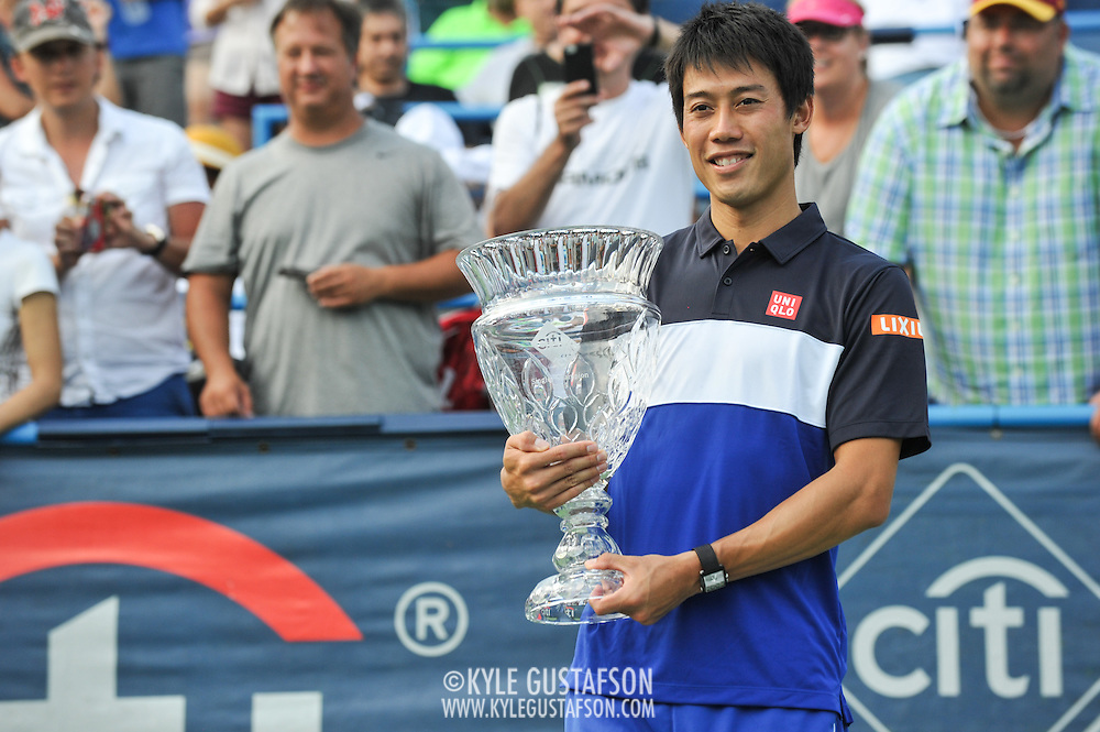 KEI NISHIKORI of Japan holds his trophy after winning the men's final of the Citi Open at the Rock Creek Tennis Center in Washington, D.C. Nishikori beat John Isner of the United States in 3 sets.