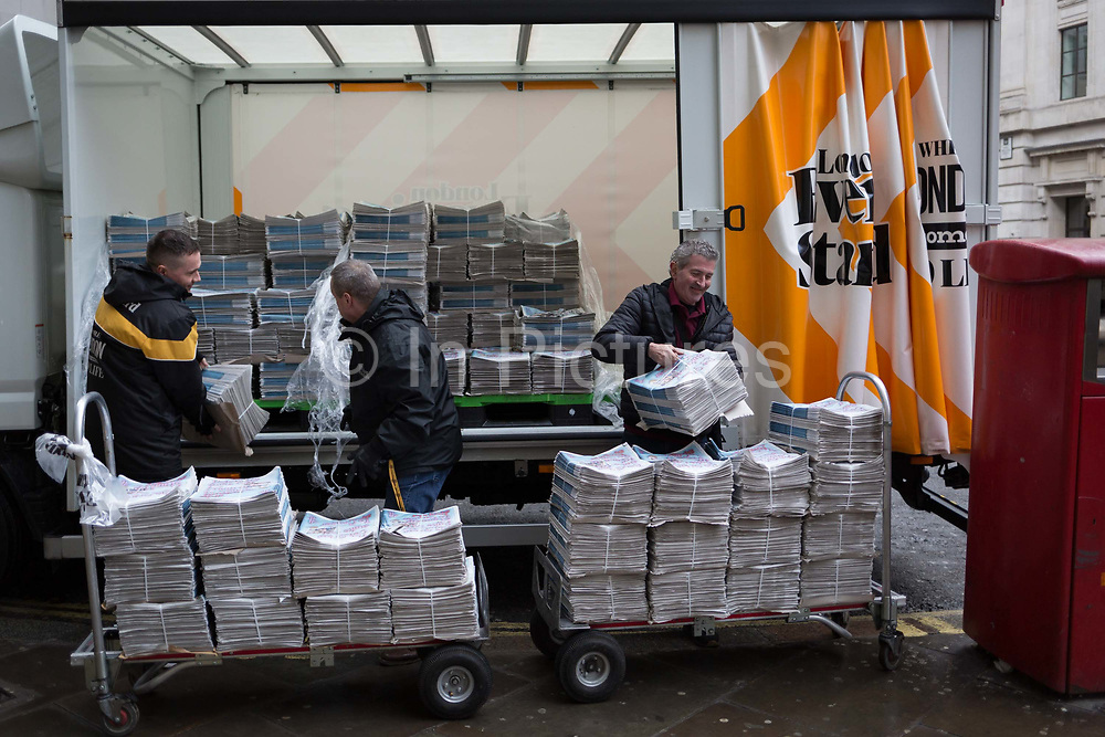 Newspaper delivery men unload a van of Evening Standard first editions onto trolleys for distribution in the Bank area in the City of London, the capitals financial district, 7th March 2018, in London England.