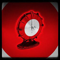 Vintage Atomic Era Modernist Europa Sunburst Executive Clock Photo illustration in red