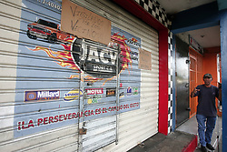 May 5, 2017 - Valencia, Carabobo, Venezuela - Before the wave of looting in different sectors of the city of Valencia, the neighbors of the avenue Arantzazu with avenue Enrique Tejera, placed posters to different businesses ''Protected by the neighbors'' in order that the groups of looters did not attack because the community the Would face.Photo: Juan Carlos Hernandez (Credit Image: © Juan Carlos Hernandez via ZUMA Wire)