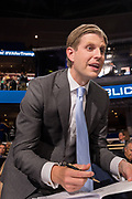 Eric Trump, son of GOP presidential nominee Donald Trump, autographs a book for a supporter during the second day of the Republican National Convention via live video link July 19, 2016 in Cleveland, Ohio. Earlier in the day the delegates formally nominated Donald J. Trump for president.