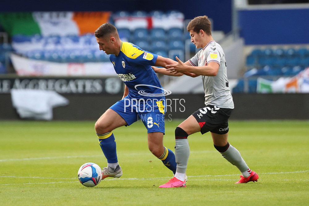 AFC Wimbledon midfielder Anthony Hartigan (8) dribbling and battles for possession during the EFL Trophy Group O match between AFC Wimbledon and Charlton Athletic at the Kiyan Prince Foundation Stadium, London, England on 1 September 2020.