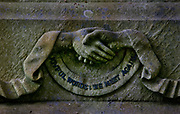 "Gravestone with clasped hands In Highgate Cemetery with the words, ""Joyful Words: We Meet Again"", 25th May, 2005, Highgate, London, United Kingdom.  The cemetery in its original form (the older, Western part) was consecrated by the Bishop of London on 20th May 1839. It was part of an initiative to provide seven large, modern cemeteries to ring the city of London. The inner-city cemeteries, mostly the graveyards of individual churches, had long been unable to cope with the number of burials and were seen as a health hazard and an undignified way to treat the dead. (photo by Barry Lewis/In<br /> Pictures via Getty Images)"