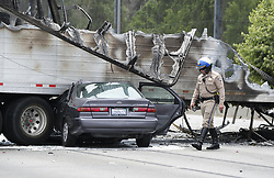 April 25, 2017 - Los Angeles, California, U.S - Firefighters and police officers inspect the scene after a multi-vehicle crash involving two big rigs and multiple passenger vehicles, on Interstate 5 Freeway near Griffith Park, Tuesday. The crash left one person dead and nine others injured, one critically and forced the closure of the Golden State (5) Freeway in both directions in the Los Feliz area. (Credit Image: © Ringo Chiu via ZUMA Wire)