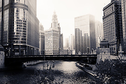 Hazy Chicago River skyline at Wabash Avenue bridge with Trump Tower and the Wrigley Building