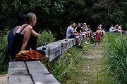 People enjoy the hot weather in the Hampstead Heath in Northwest London on Friday, Aug 7, 2020, as the UK could see record-breaking temperatures with forecasters predicting Friday as the hottest day of the year. (VXP Photo/ Vudi Xhymshiti)