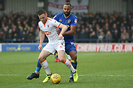 AFC Wimbledon midfielder Liam Trotter (14) battles for possession during the EFL Sky Bet League 1 match between AFC Wimbledon and Blackpool at the Cherry Red Records Stadium, Kingston, England on 20 January 2018. Photo by Matthew Redman.